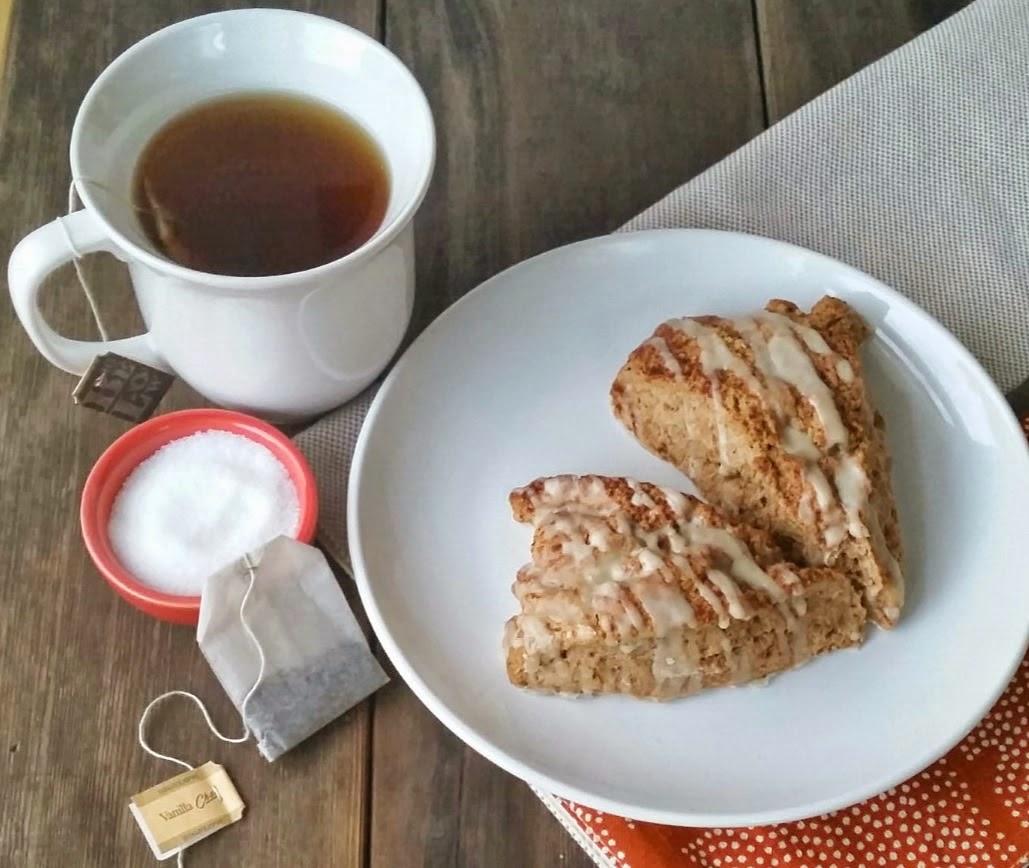 vanilla chai tea and truvia wirh a cinnamon scone