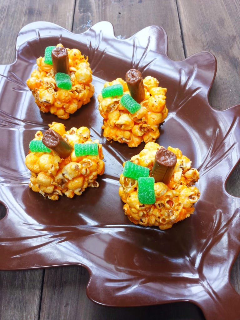 pumkin popcorn balls on a leaf plate