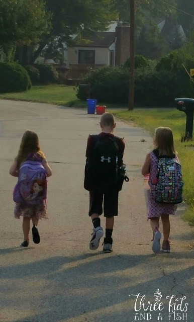 three kids going to school